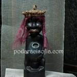 Екзотична фигура от дърво с декорация от слама